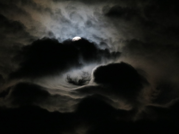 Strange Clouds Embrace the Moon